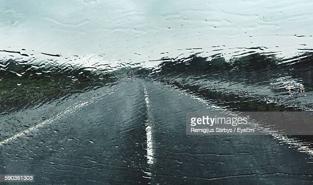 road against sky seen through wet windshield during monsoon - torrential rain stock pictures, royalty-free photos & images