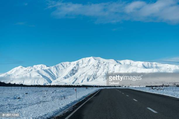 Road against Snowcapped Mountain