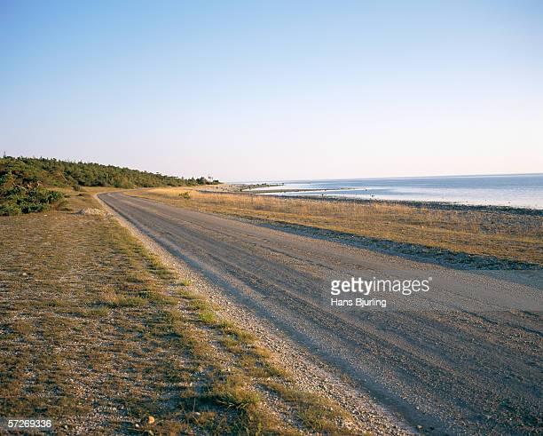A road along a coastline in Gotland, Sweden.