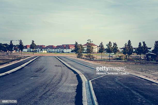 road along trees - albrecht schlotter stock photos and pictures