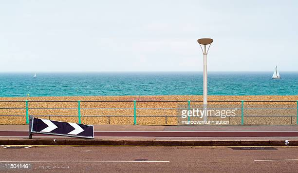 road alongside the beach, with sea in the background - marcoventuriniautieri stock pictures, royalty-free photos & images
