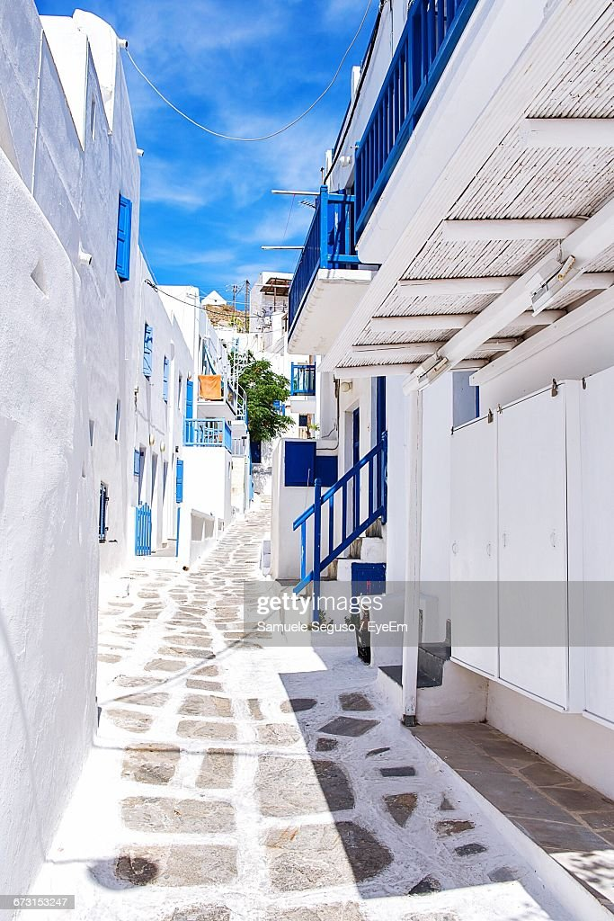 Road Amidst Buildings At Mykonos : Stock Photo