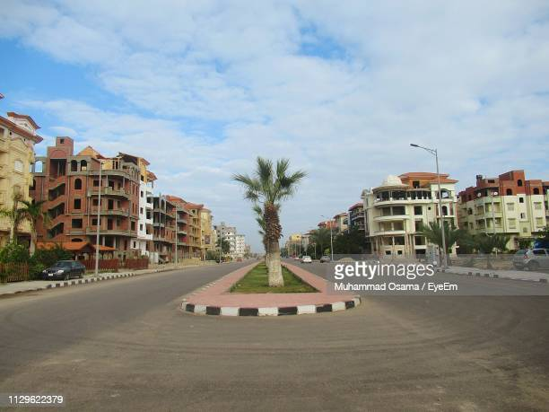 road amidst buildings in city against sky - north africa stock pictures, royalty-free photos & images