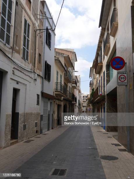 road amidst buildings in city - manacor stock pictures, royalty-free photos & images