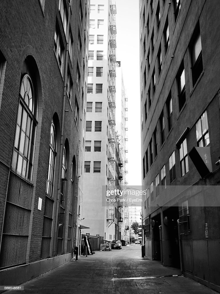Road Amidst Buildings In City : Stock Photo