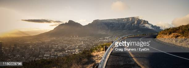 road amidst cityscape against sky - cape town stock pictures, royalty-free photos & images