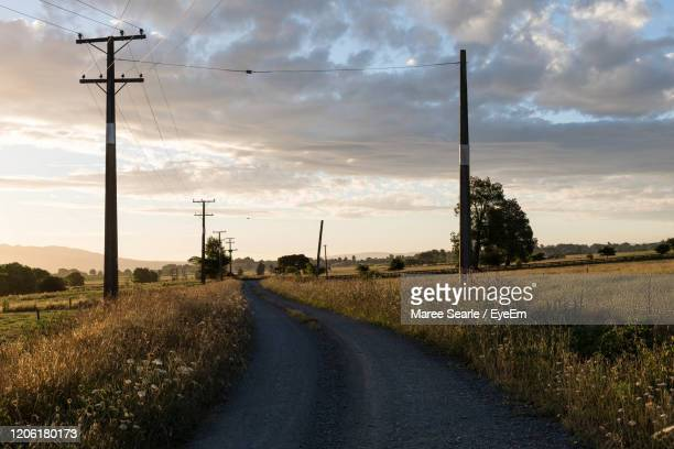 road amidst field against sky - cambridge new zealand stock pictures, royalty-free photos & images