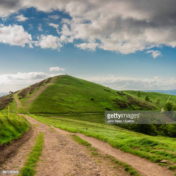 road amidst green landscape against sky - worcestershire stock photos and pictures