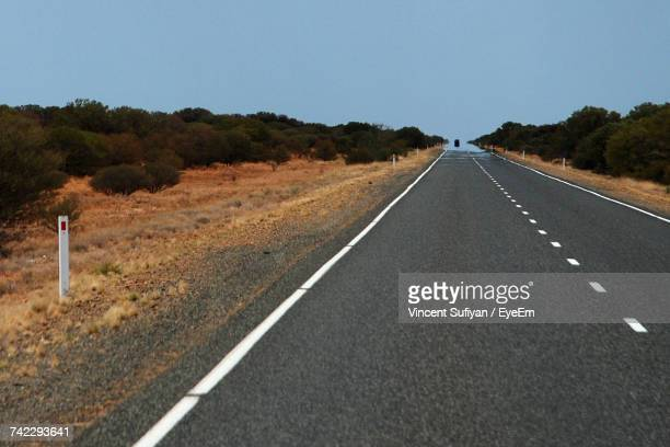 Road Amidst Landscape Against Clear Sky