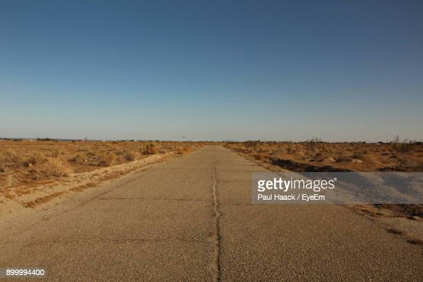 road amidst landscape against clear sky - haack stock pictures, royalty-free photos & images