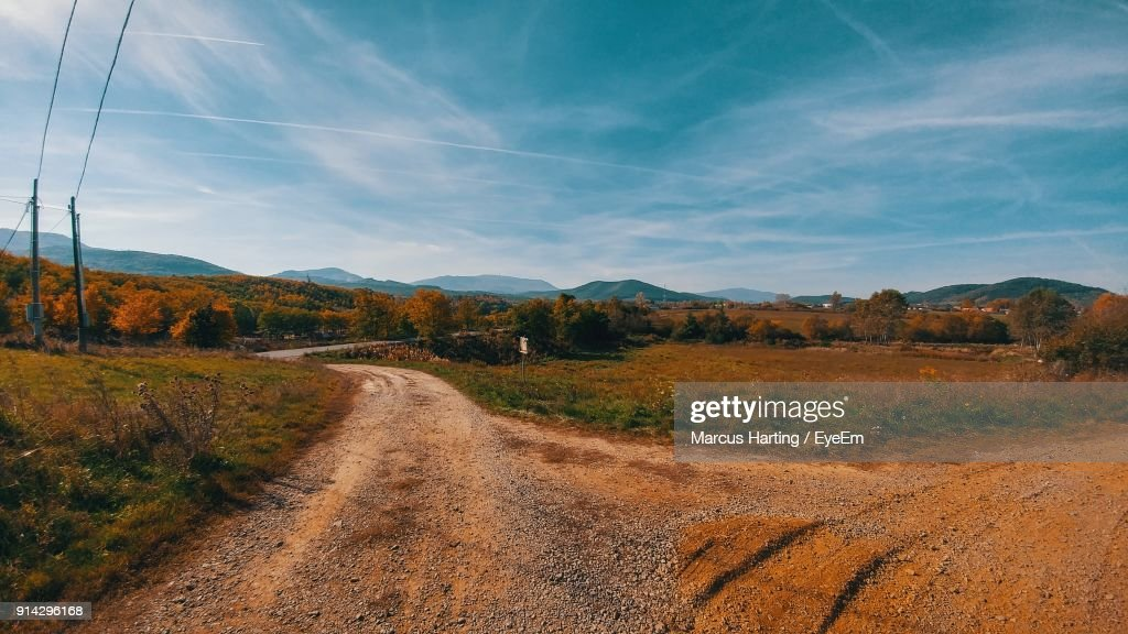 Road Amidst Landscape Against Sky : Stock Photo