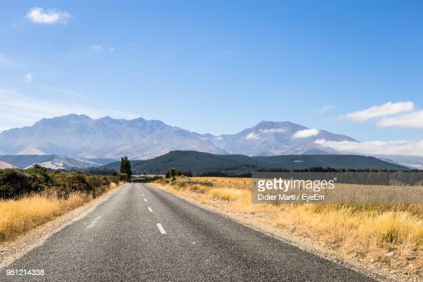 road amidst landscape against sky - invercargill stock pictures, royalty-free photos & images