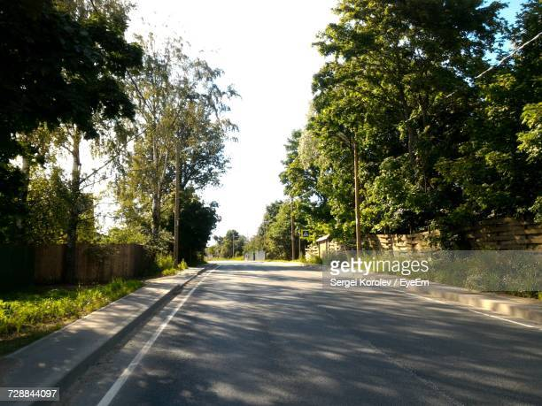 road amidst trees against sky - sergei stock pictures, royalty-free photos & images