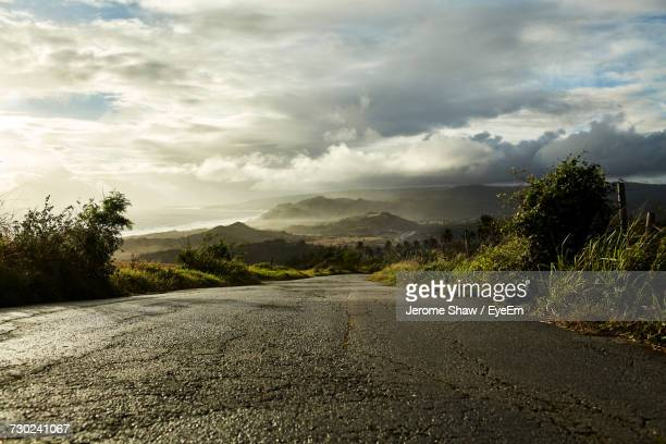 road amidst trees against sky - bridgetown barbados stock photos and pictures