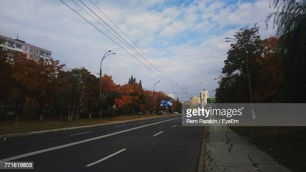 road amidst trees against sky - moldova stock pictures, royalty-free photos & images