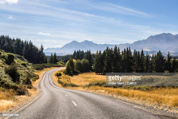 road amidst trees against sky - invercargill stock pictures, royalty-free photos & images