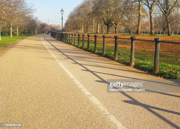 road amidst trees and plants against sky - hyde park london stock pictures, royalty-free photos & images