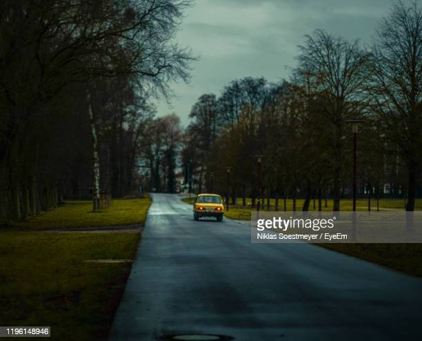 road amidst trees in city against sky - thuringia stock pictures, royalty-free photos & images