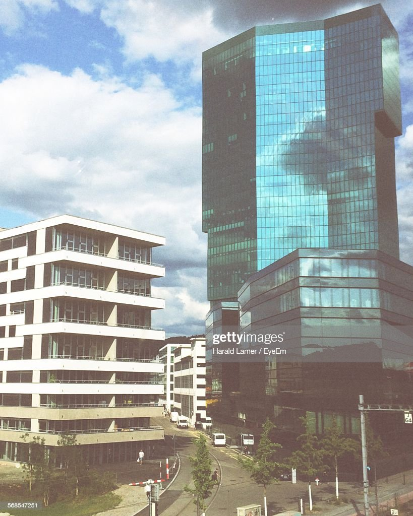 Road And Buildings Against Cloudy Sky : Stock Photo