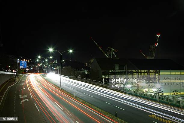 Road and crane at night