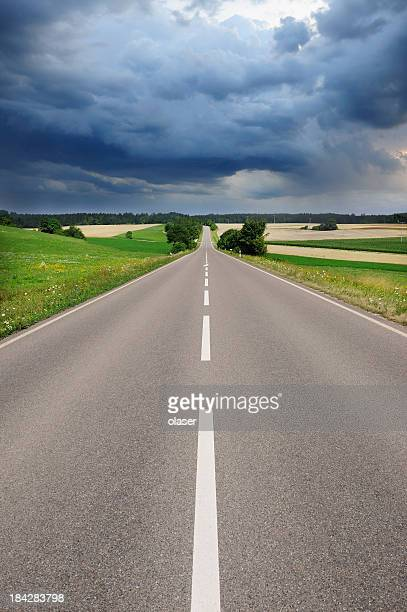 road and dramatic sky, fresh asphalt - mid section stock photos and pictures