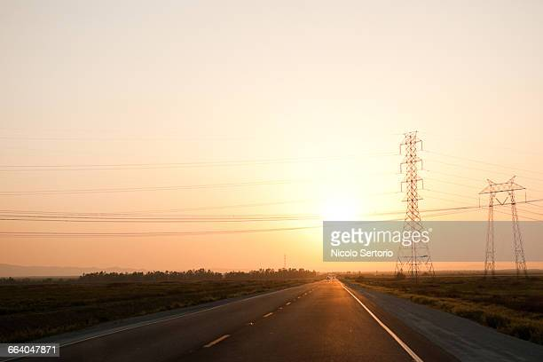 road and electric wires at sunset