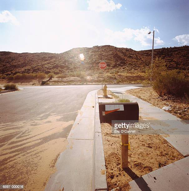road and mailbox in desert - domestic mailbox stock pictures, royalty-free photos & images