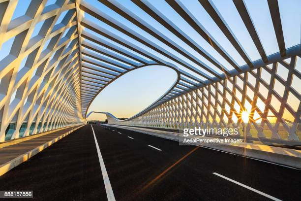 Road and Modern bridge in Sunlight