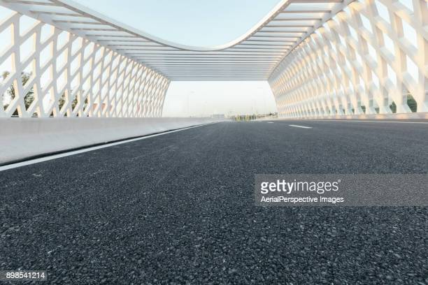 road and modern bridge - low angle view stock pictures, royalty-free photos & images
