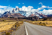Road and panorama with Fitz Roy mountain at Los Glaciares National Park