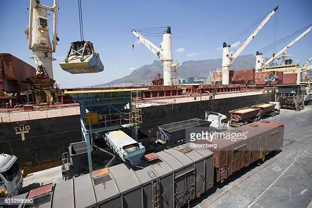 Road and rail transport wagons wait to load up with imported corn maize from a cargo vessel at the city port in Cape Town South Africa on Thursday...