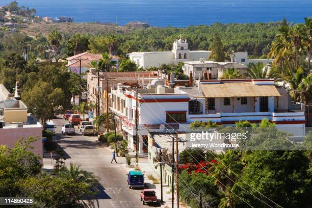 road and rooftops of town - todos santos mexico fotografías e imágenes de stock