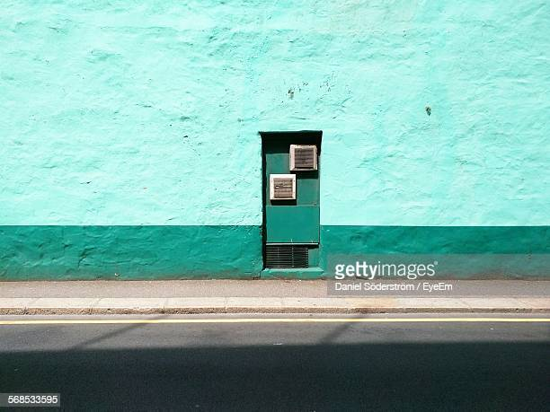 Road And Sidewalk Against Turquoise Colored Wall