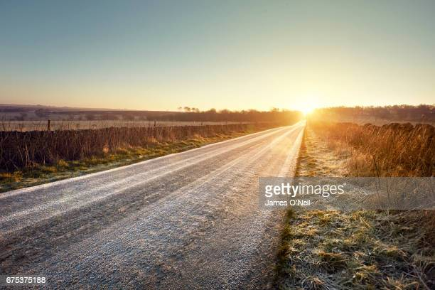 road and sunrise - country road stock pictures, royalty-free photos & images