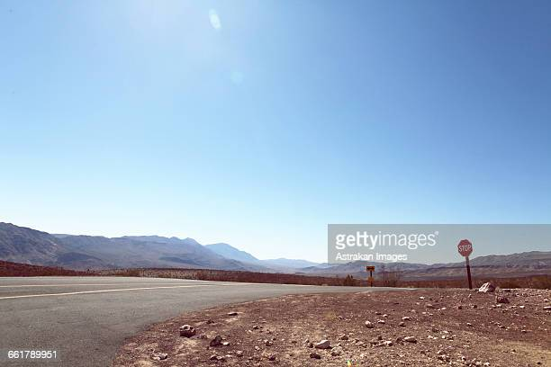 Road at Death Valley National Park against clear blue sky