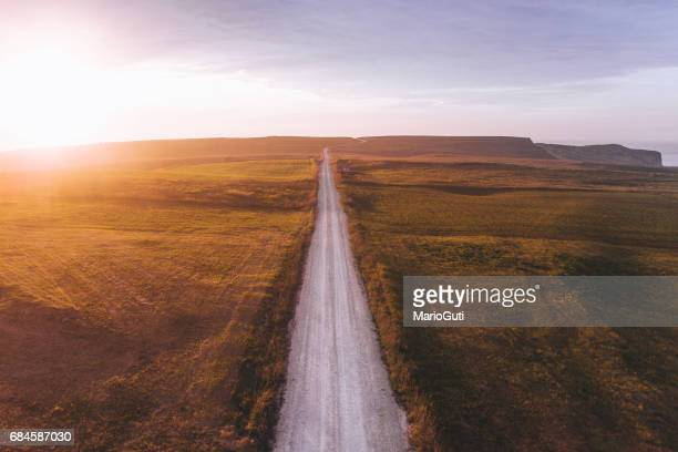 road at sunset - thoroughfare stock photos and pictures