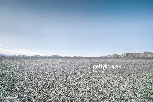 road background - pebble stock pictures, royalty-free photos & images