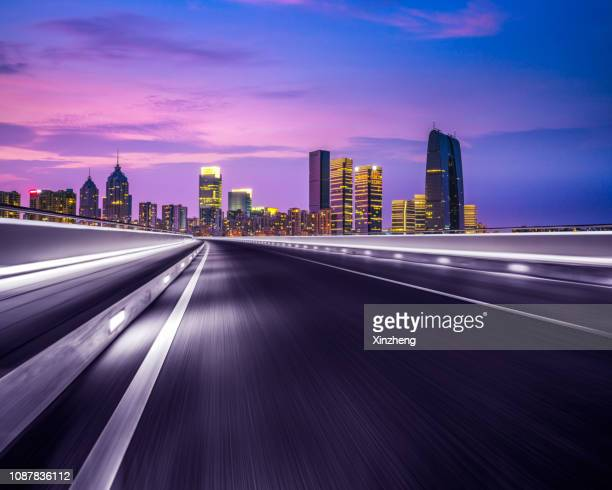 road background - paved driveway stock pictures, royalty-free photos & images