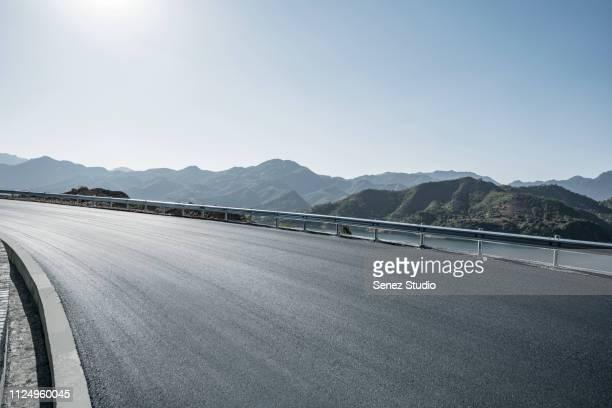 road background - curvar se - fotografias e filmes do acervo
