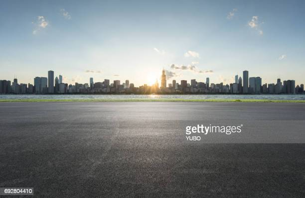 road background - chicago skyline stock photos and pictures