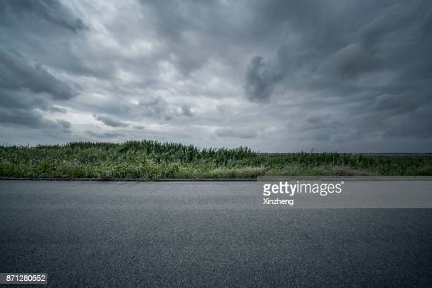 road background - dramatic sky stock pictures, royalty-free photos & images