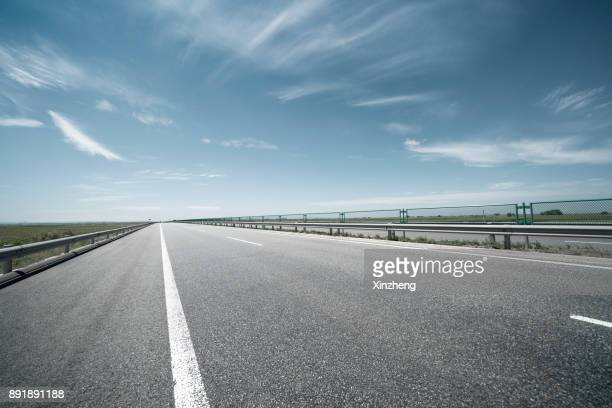 road background - multiple lane highway stock pictures, royalty-free photos & images