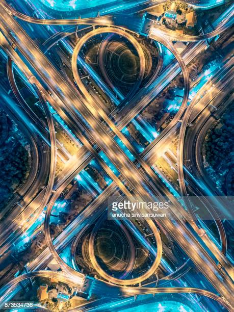 road beautiful aerial view of busy intersection at night , top view , thailand . - crossroad stock pictures, royalty-free photos & images