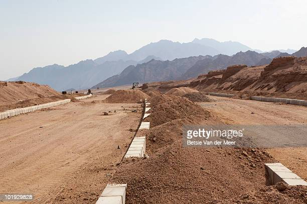 Road being build in desert.