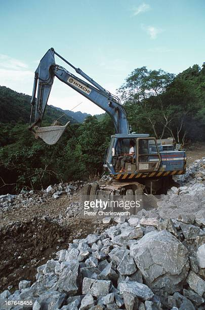 A road being constructed by a Vietnamese Army Construction Company through the Phong Nha Nature Reserve The Vietnamese Government is proposing that...