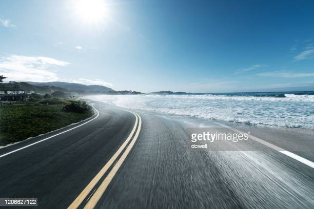 road beside beach - close to stock pictures, royalty-free photos & images