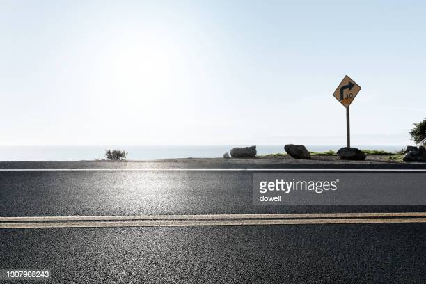 road beside coast - close to stock pictures, royalty-free photos & images