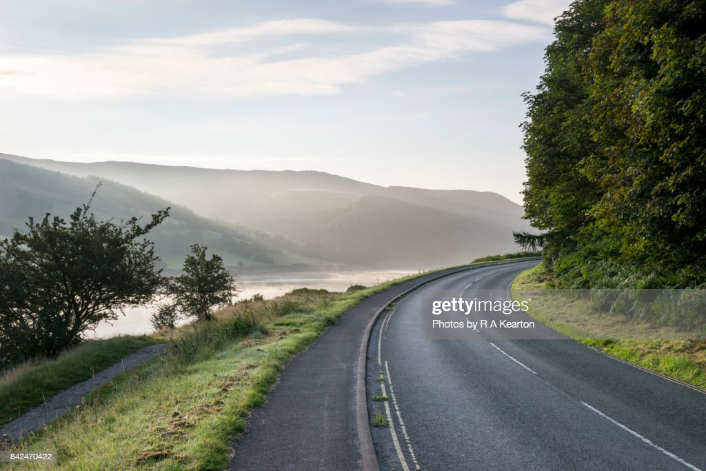 Road beside Ladybower reservoir on a misty autumn morning : Stock Photo