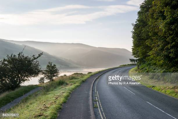Road beside Ladybower reservoir on a misty autumn morning