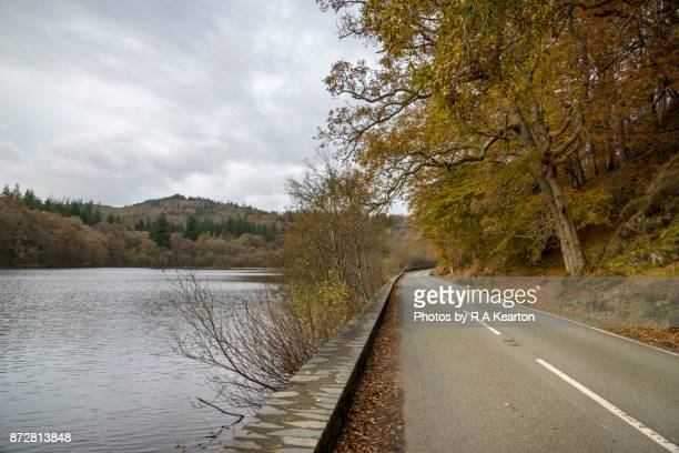 road beside llyn mair, snowdonia, on an autumn day - next to stock pictures, royalty-free photos & images
